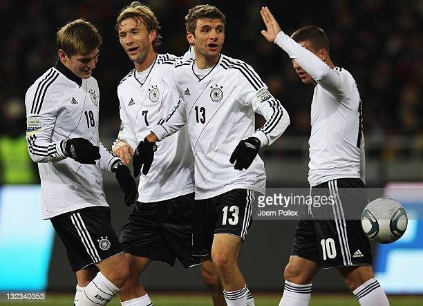 Thomas Mueller of Germany celebrates with his team mates after scoring his team's third goal during the International Friendly match between Ukraine...