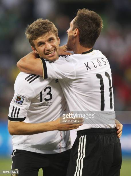 Thomas Mueller of Germany celebrates with team mate Miroslav Klose during the 2010 FIFA World Cup South Africa Round of Sixteen match between Germany...