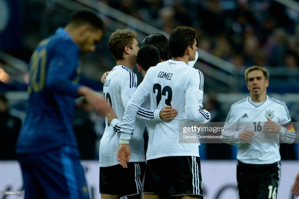 Thomas Mueller of Germany celebrates with teammates after scoring during the international friendly match between France and Germany at Stade de France on February 6, 2013 in Paris, France.
