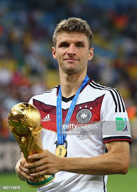 Thomas Mueller of Germany celebrates with the World Cup trophy after defeating Argentina 10 in extra time during the 2014 FIFA World Cup Brazil Final...