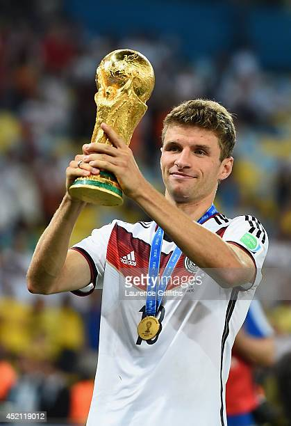 Thomas Mueller of Germany celebrates with the World Cup trophy after defeating Argentina 1-0 in extra time during the 2014 FIFA World Cup Brazil...