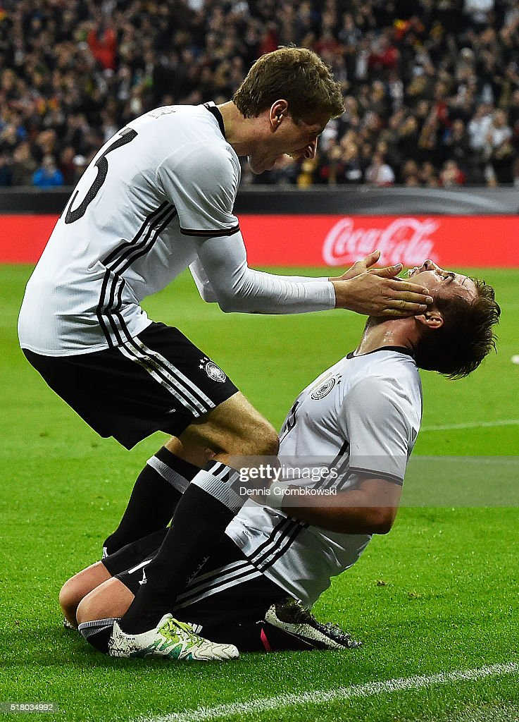 Thomas Mueller of Germany congratulates Mario Goetze of Germany after he scored the second goal during the International Friendly match between Germany and Italy at Allianz Arena on March 29, 2016 in Munich, Germany.
