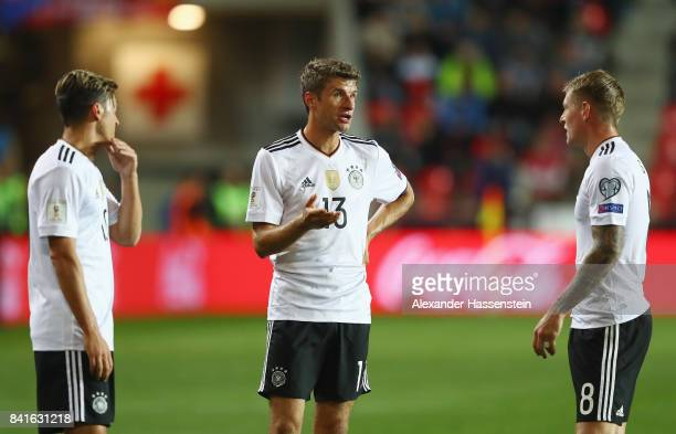 Thomas Mueller of Germany discusses with team mates Mesut Oezil and Toni Kroos during the FIFA World Cup Russia 2018 Group C Qualifier between Czech...