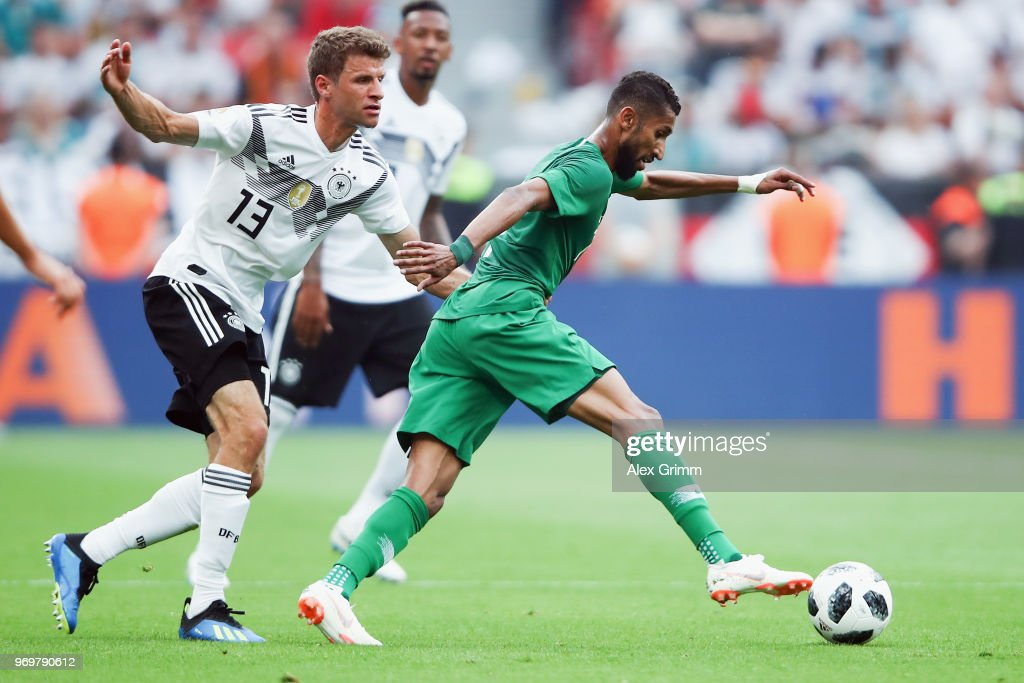 Thomas Mueller of Germany holds Salman Al-Faraj of Saudi Arabia during the international friendly match between Germany and Saudi Arabia ahead of the FIFA World Cup Russia 2018 at BayArena on June 8, 2018 in Leverkusen, Germany.