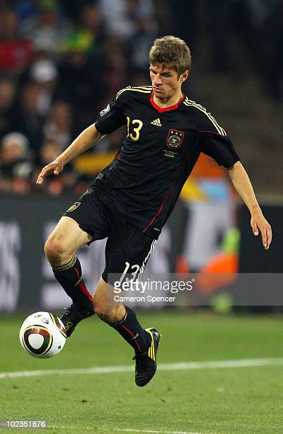 Thomas Mueller of Germany in action during the 2010 FIFA World Cup South Africa Group D match between Ghana and Germany at Soccer City Stadium on...
