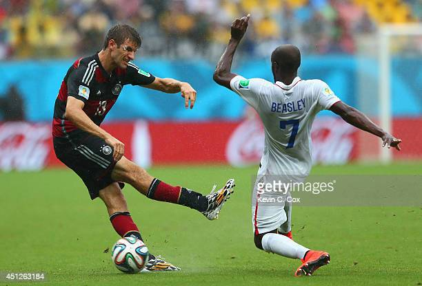 Thomas Mueller of Germany is challenged by DaMarcus Beasley of the United States during the 2014 FIFA World Cup Brazil group G match between the...