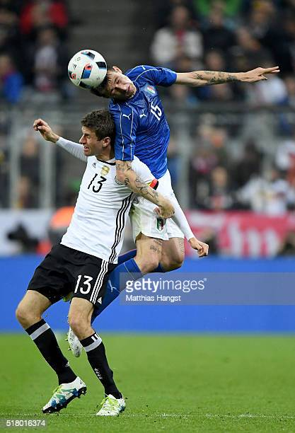 Thomas Mueller of Germany is challenged by Francesco Acerbi of Italy during the International Friendly match between Germany and Italy at Allianz...