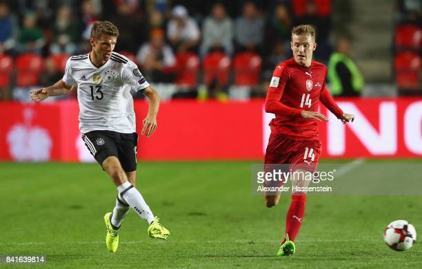 Thomas Mueller of Germany is challenged by Jakub Jankto of Czech Republik during the FIFA World Cup Russia 2018 Group C Qualifier between Czech...