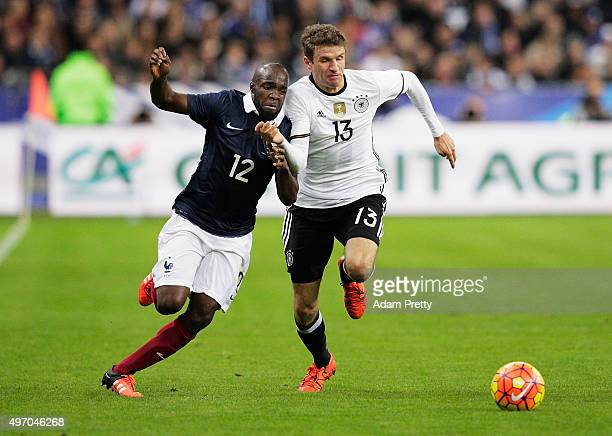 Thomas Mueller of Germany is challenged by Lassana Diarra of France during the International Friendly match between France and Germany at the Stade...