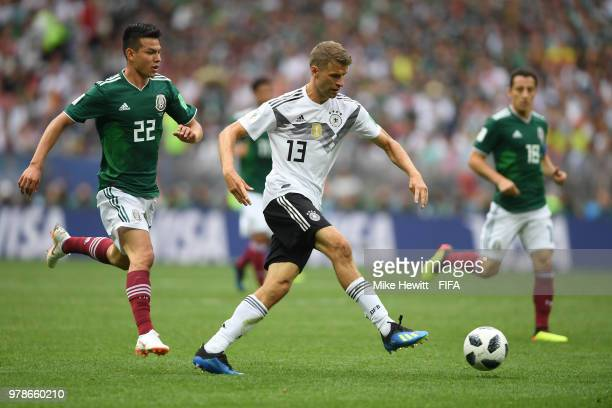Thomas Mueller of Germany is chased by Hirving Lozano during the 2018 FIFA World Cup Russia group F match between Germany and Mexico at Luzhniki...