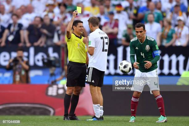 Thomas Mueller of Germany is shown a yellow card by Referee Alireza Faghani during the 2018 FIFA World Cup Russia group F match between Germany and...
