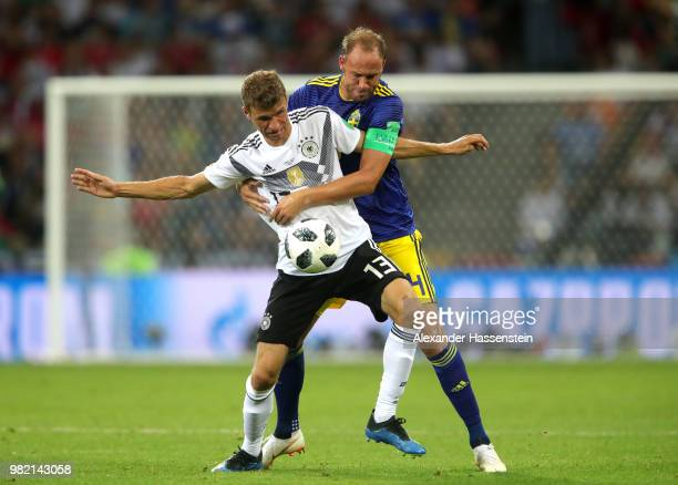 Thomas Mueller of Germany is tackled by Andreas Granqvist of Sweden during the 2018 FIFA World Cup Russia group F match between Germany and Sweden at...