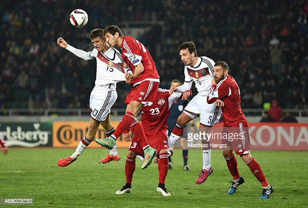 Thomas Mueller of Germany jumps for a header Lasah Dvali of Georgia during the EURO 2016 Group D Qualifier match between Georgia and Germany at Boris...