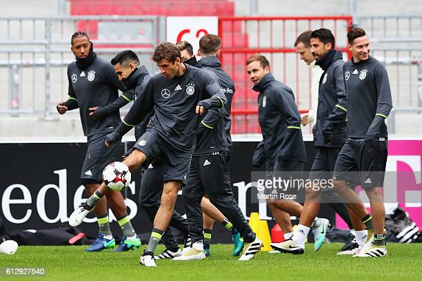Thomas Mueller of Germany kicks a ball during a training session at Millerntor Stadion on October 6 2016 in Hamburg Germany