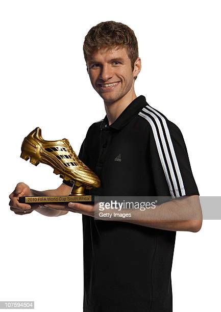 Thomas Mueller of Germany poses with the adidas Golden Boot Winner Trophy at the adidas HQ on December 14 2010 in Herzogenaurach Germany
