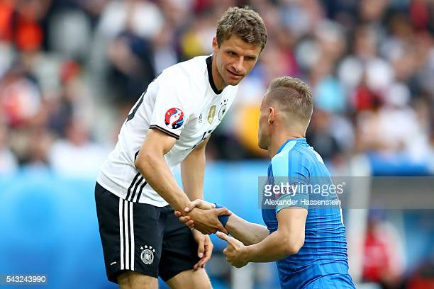 Thomas Mueller of Germany reacts with Jan Durica of Slovakia during the UEFA EURO 2016 round of 16 match between Germany and Slovakia at Stade...