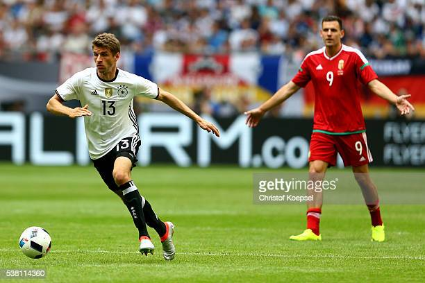 Thomas Mueller of Germany runs with the ball during the International Friendly match between Germany and Hungary at VeltinsArena on June 4 2016 in...