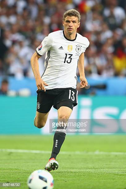 Thomas Mueller of Germany runs with the ball during the UEFA EURO 2016 Group C match between Germany and Ukraine at Stade PierreMauroy on June 12...
