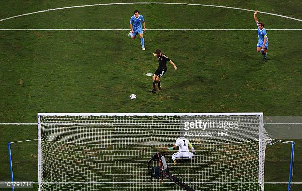Thomas Mueller of Germany scores his side's first goal during the 2010 FIFA World Cup South Africa Third Place Playoff match between Uruguay and...