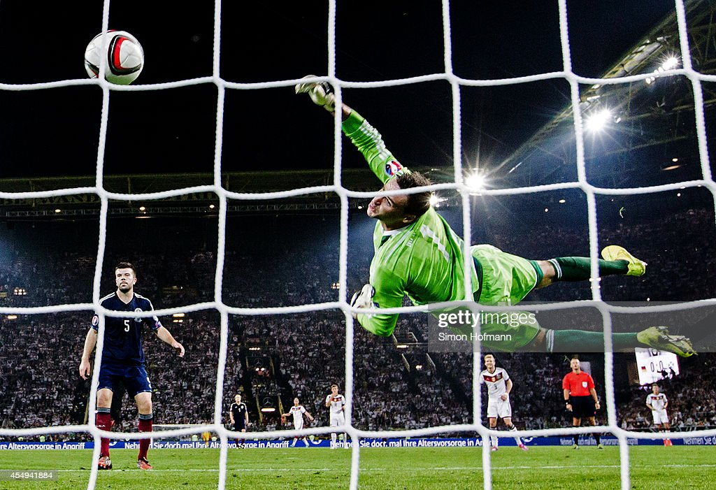 Thomas Mueller of Germany (not pictured) scores his team's first goal against goalkeeper David Marshall of Scotland during the EURO 2016 Qualifier match between Germany and Scotland at Signal Iduna Park on September 7, 2014 in Dortmund, Germany.