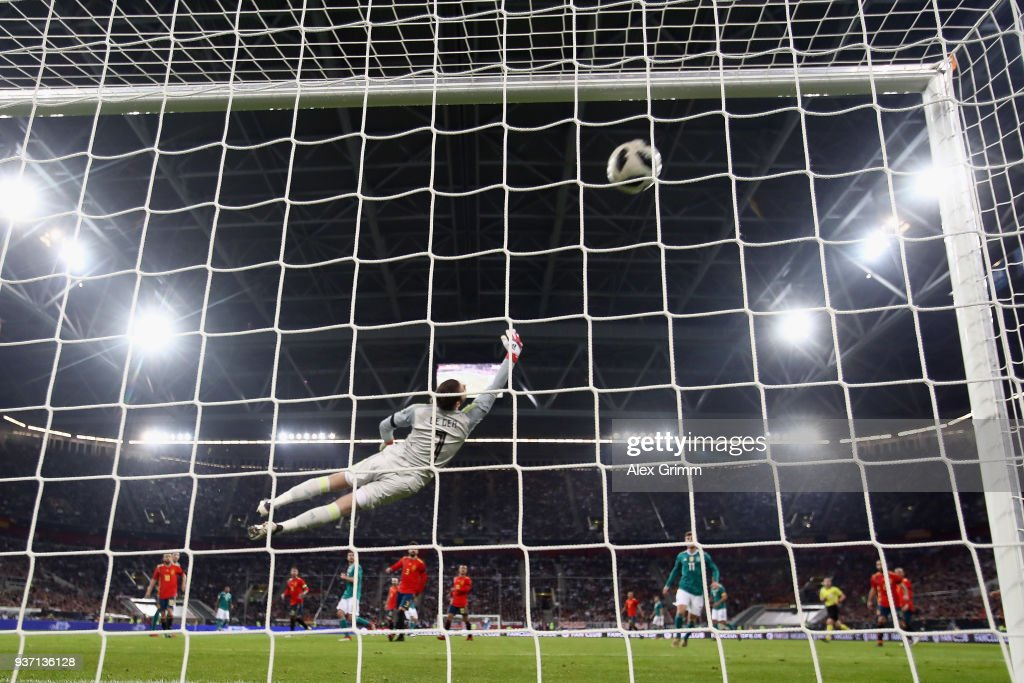 Thomas Mueller of Germany scores his team's first goal past goalkeeper David de Gea of Spain during the international friendly match between Germany and Spain at Esprit-Arena on March 23, 2018 in Duesseldorf, Germany.