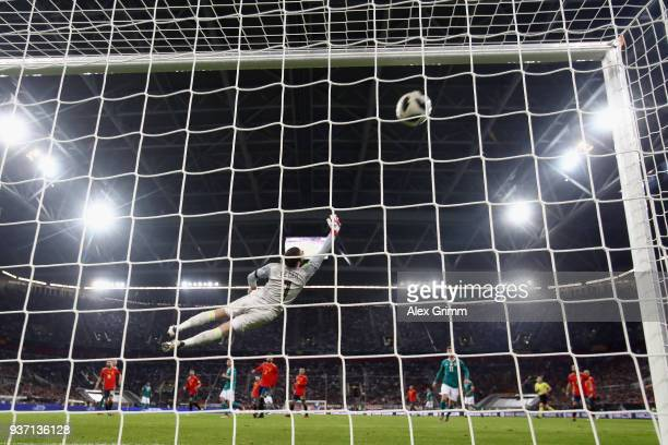Thomas Mueller of Germany scores his team's first goal past goalkeeper David de Gea of Spain during the international friendly match between Germany...