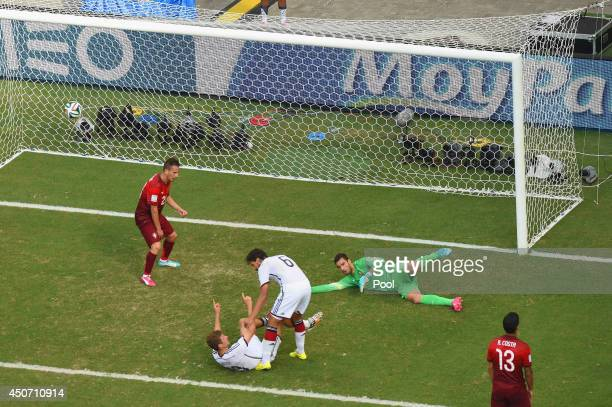 Thomas Mueller of Germany scores his team's fourth goal and completes his hat trick past Rui Patricio of Portugal during the 2014 FIFA World Cup...