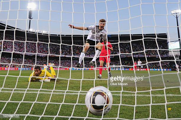 Thomas Mueller of Germany scores his teams fourth past goal David James of England during the 2010 FIFA World Cup South Africa Round of Sixteen match...