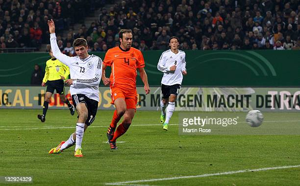 Thomas Mueller of Germany scores his team's opening goal during the International friendly match between Germany and Netherlands at Imtech Arena on...