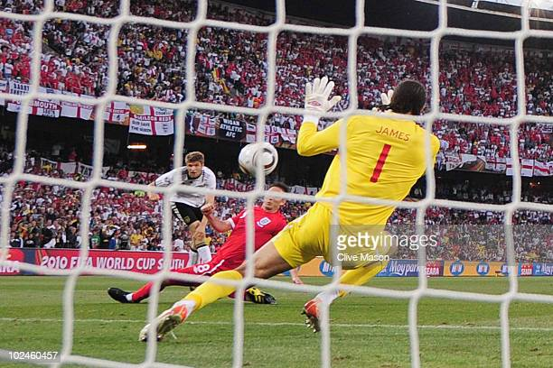 Thomas Mueller of Germany scores his teams third goal past David James of England during the 2010 FIFA World Cup South Africa Round of Sixteen match...