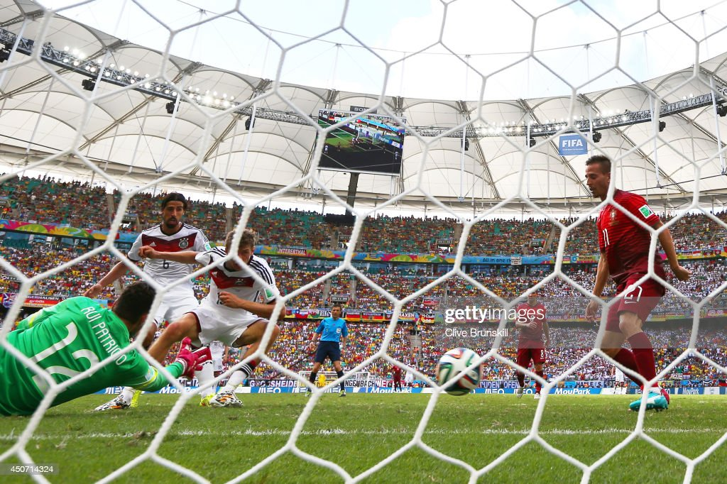 Thomas Mueller of Germany scores the fourth goal during the 2014 FIFA World Cup Brazil Group G match between Germany and Portugal at Arena Fonte Nova on June 16, 2014 in Salvador, Brazil.