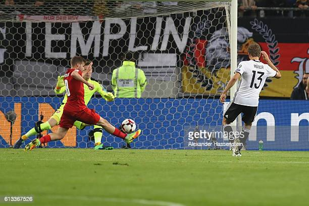 Thomas Mueller of Germany scores the opening goal during the 2018 FIFA World Cup Qualifier match between Germany and Czech Republic at...