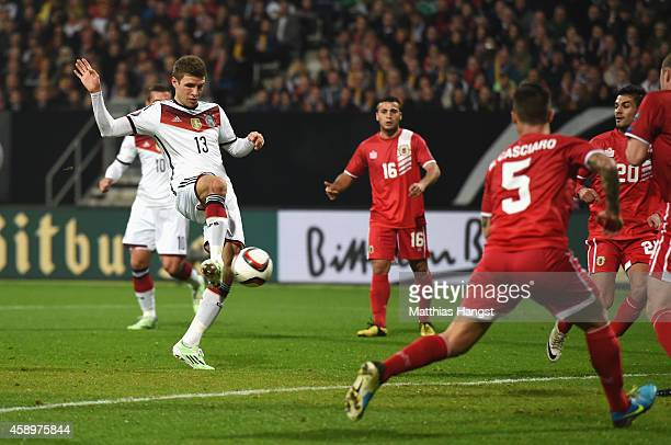 Thomas Mueller of Germany scores the opening goal during the EURO 2016 Group D Qualifier match between Germany and Gibraltar at Grundig Stadion on...