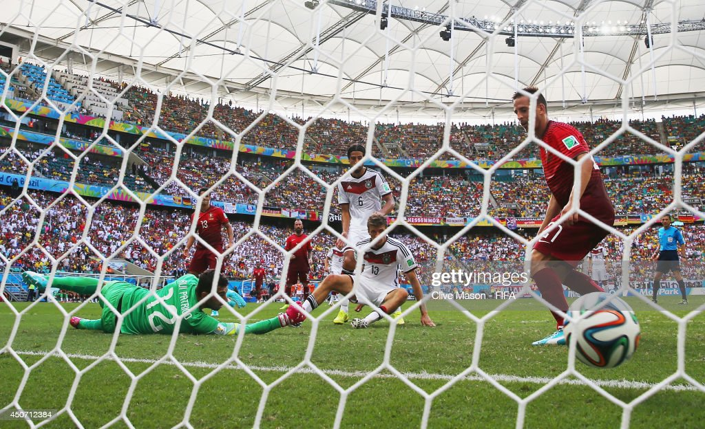 Thomas Mueller of Germany scores the team's fourth goal past Rui Patricio of Portugal during the 2014 FIFA World Cup Brazil Group G match between Germany and Portugal at Arena Fonte Nova on June 16, 2014 in Salvador, Brazil.