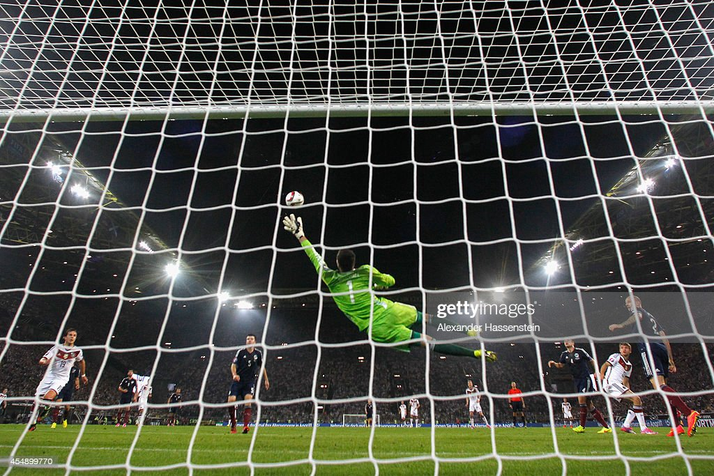 Thomas Mueller of Germany (obscured 2R) scores their first goal with a header past goalkeeper David Marshall of Scotland during the EURO 2016 Group D qualifying match between Germany and Scotland at Signal Iduna Park on September 7, 2014 in Dortmund, Germany.