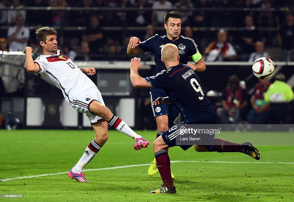 Thomas Mueller of Germany (13) scores their second goal during the EURO 2016 Group D qualifying match between Germany and Scotland at Signal Iduna Park on September 7, 2014 in Dortmund, Germany.