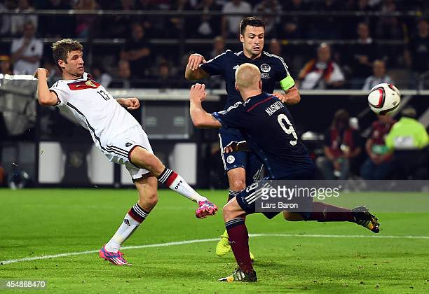 Thomas Mueller of Germany scores their second goal during the EURO 2016 Group D qualifying match between Germany and Scotland at Signal Iduna Park on...