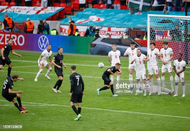 Thomas Mueller of Germany shoots from a free kick during the UEFA Euro 2020 Championship Round of 16 match between England and Germany at Wembley...