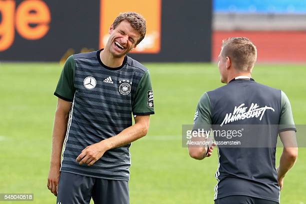 Thomas Mueller of Germany smiles with his team mate Toni Kroos during a Germany training session at Ermitage Evian on July 05 2016 in EvianlesBains...