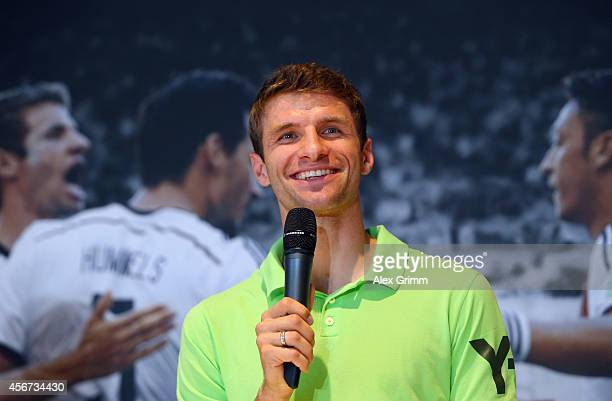 Thomas Mueller of Germany talks during a press conference after receiving the adidas Silver Ball and adidas Silver Shoe awards during his visit at...