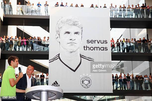 Thomas Mueller of Germany talks to the audience as he receives the adidas Silver Ball and adidas Silver Shoe awards during his visit at the adidas...