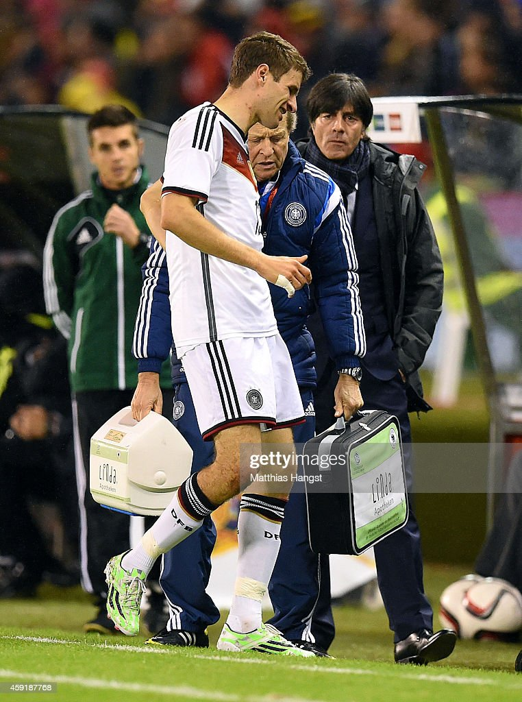 Thomas Mueller of Germany walks off the pitch after suffering an injury during the International Friendly match between Spain and Germany at Estadio Balaidos on November 18, 2014 in Vigo, Spain.