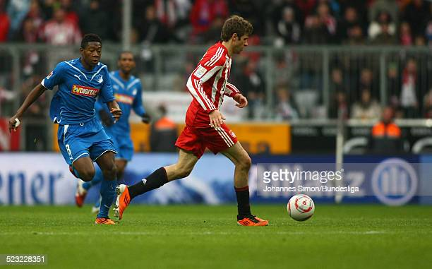 Thomas Mueller of Muenchen and David Alaba of Hoffenheim fight for the ball during the Bundesliga match between FC Bayern Muenchen and 1899...