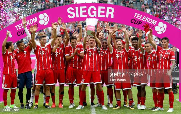 Thomas Mueller of Muenchen and his team mates celebrate with the trophy after winning the Telekom Cup 2017 Final between SV Werder Bremen and FC...
