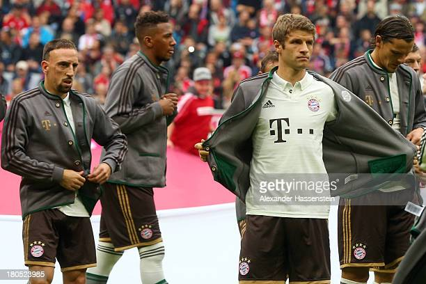 Thomas Mueller of Muenchen and his team mates Franck Ribery Jerome Boateng and Daniel van Buyten walk in with the new away kit for the Bundesliga...