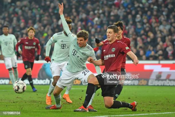 Thomas Mueller of Muenchen and Kevin Wimmer of Hannover fight for the ball during the Bundesliga match between Hannover 96 and FC Bayern Muenchen at...
