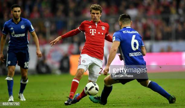 Thomas Mueller of Muenchen and Sead Kolasinac of Schalke battle for the ball during the Bundesliga match between Bayern Muenchen and FC Schalke 04 at...
