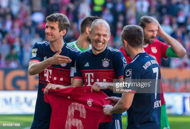 Thomas Mueller of Muenchen Arjen Robben of Muenchen and Franck Ribery of Muenchen celebrate after winning the Bundesliga match between FC Augsburg...