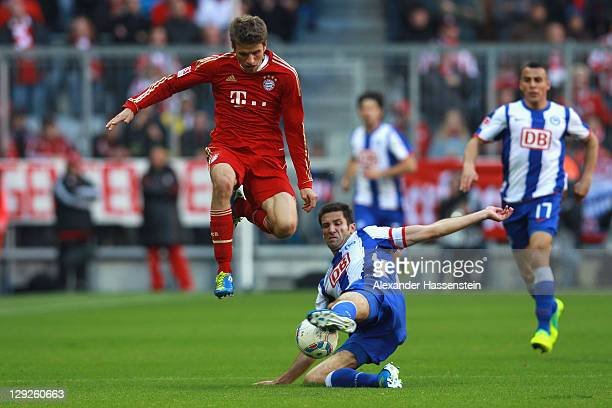 Thomas Mueller of Muenchen battles for the ball with Andre Mijatovic of Berlin during the Bundesliga match between FC Bayern Muenchen and Hertha BSC...