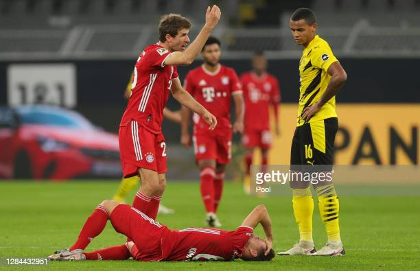 Thomas Mueller of Muenchen calls for help for injured teammate Joshua Kimmich during the Bundesliga match between Borussia Dortmund and FC Bayern...